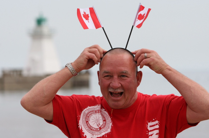 Happy Canadian with flags